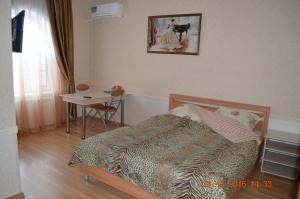 Кровать или кровати в номере Guesthouse Taymirskaya 12