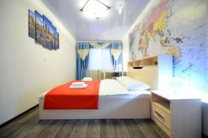 Кровать или кровати в номере Пять Звёзд Семья