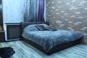 Кровать или кровати в номере Apartments Perm