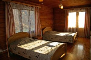 A bed or beds in a room at Listvyanka Chalet