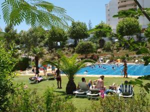 The swimming pool at or near Apartamentos Jardins da Rocha