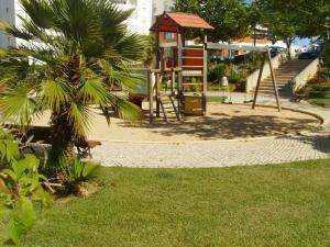 Children's play area at Apartamentos Jardins da Rocha