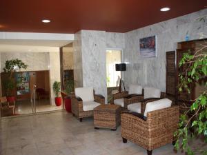 The lobby or reception area at Apartamentos Jardins da Rocha