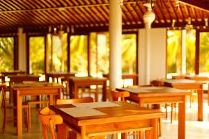 A restaurant or other place to eat at Anga Hotel