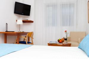 A bed or beds in a room at Hotel Verol