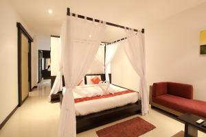 A bed or beds in a room at Seastone Private Pool Villas