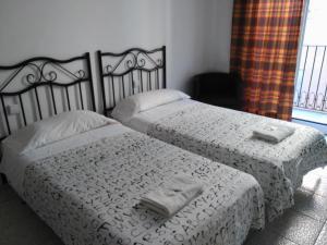 Cama o camas de una habitación en Hostal River