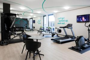 The fitness center and/or fitness facilities at Radisson Blu Hotel, Mannheim