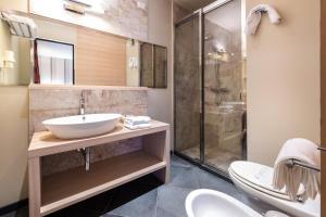 A bathroom at El Homs Palace Hotel