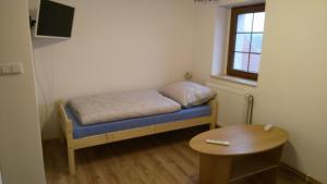 Кровать или кровати в номере Podřipská Farma