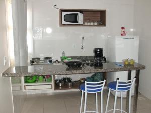 A cozinha ou cozinha compacta de Lacqua Diroma Apartment