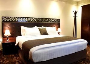Cama ou camas em um quarto em Procare Apart hotel