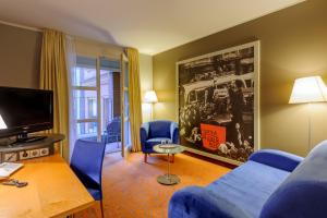 A seating area at Mercure Hotel & Residenz Berlin Checkpoint Charlie