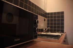 Telewizja i/lub zestaw kina domowego w obiekcie Na Kopernika