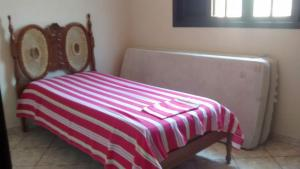 A bed or beds in a room at Casa Oliveira