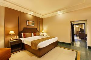 Cama o camas de una habitación en Ganga Lahari by Leisure Hotels