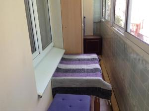 Кровать или кровати в номере Apartments Chervonnogo Kazachestva