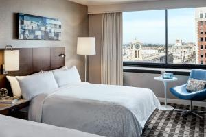A bed or beds in a room at Renaissance Long Beach Hotel