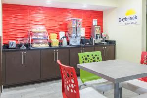 A restaurant or other place to eat at Days Inn by Wyndham Miami