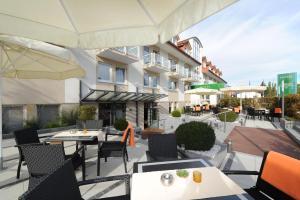 Ein Restaurant oder anderes Speiselokal in der Unterkunft Hotel Markkleeberger Hof