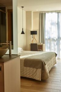 Letto o letti in una camera di Hotel Bilbao Plaza
