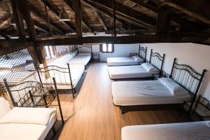 Cama o camas de una habitación en Albergue Rosalia / Pilgrim Hostel