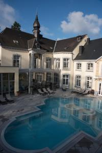 The swimming pool at or near Le Chateau Des Thermes