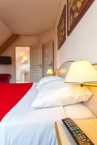 Un ou plusieurs lits dans un hébergement de l'établissement Villa Tracy Guest house