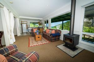 A seating area at The Cottage at The Bryn at Tilba