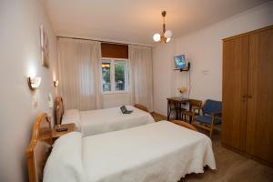 Cama o camas de una habitación en Hotel Venezuela
