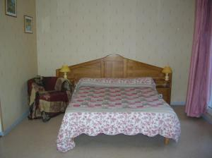 A bed or beds in a room at Les Berges du Tarn