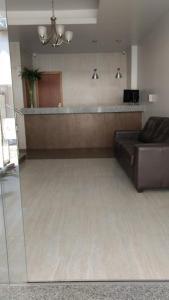 A kitchen or kitchenette at Hotel Palmeiras Ltda