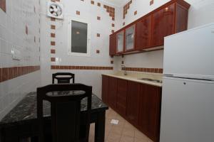 A cozinha ou cozinha compacta de Raoum Inn Shaqra