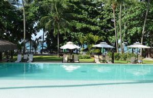 A piscina localizada em Iara Beach Hotel Boutique ou nos arredores