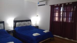 Una cama o camas en una habitación de PlazaApart 2