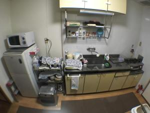 A kitchen or kitchenette at Guest House Atagoya