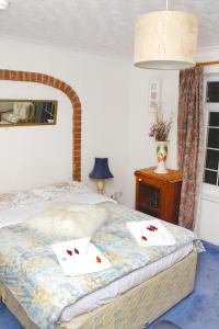 A bed or beds in a room at Da Vinci Guest House