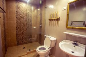 A bathroom at Oasis Resort and Spa