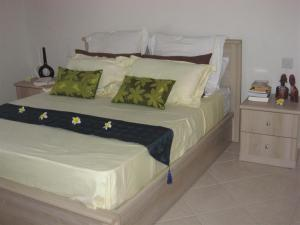 A bed or beds in a room at Villa Pupunu 1