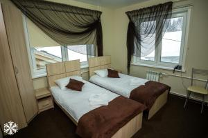 Кровать или кровати в номере Отель Зима-Лето