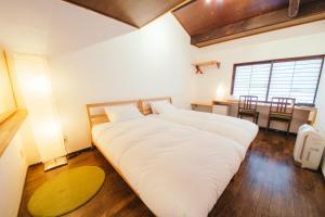 京都町家旅館 Cinq にあるベッド