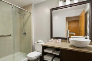 A bathroom at Days Inn by Wyndham Vancouver Downtown