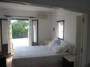 Ένα ή περισσότερα κρεβάτια σε δωμάτιο στο Agistri Club Hotel