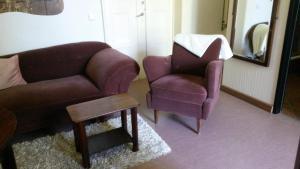 Ein Sitzbereich in der Unterkunft Herrenhaus Schmölen