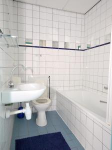 Een badkamer bij De Kabbelaar