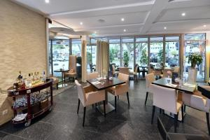 A restaurant or other place to eat at Tulip Inn Ludwigshafen City