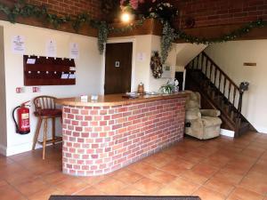 The lobby or reception area at Church Farm Guest House
