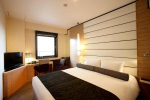 A bed or beds in a room at Hotel Trusty Osaka Abeno