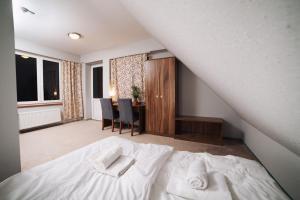 Łóżko lub łóżka w pokoju w obiekcie Gościniec Lizawka