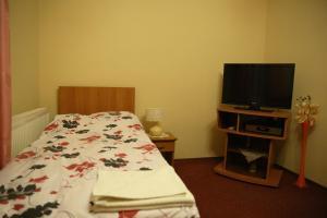 Posteľ alebo postele v izbe v ubytovaní Motel Orgován